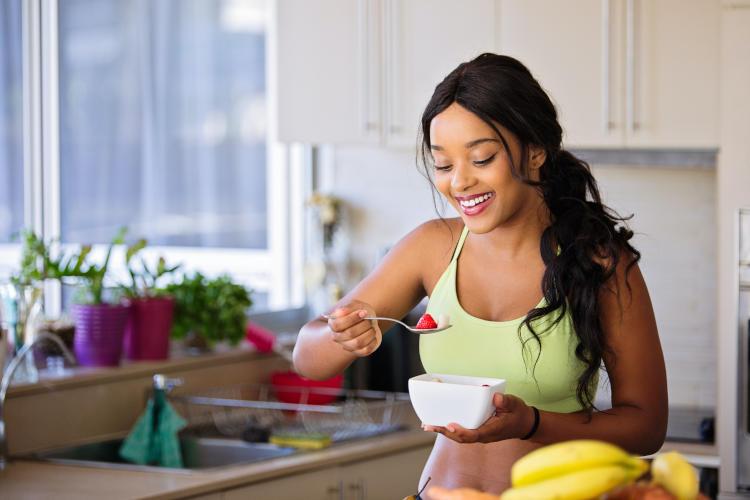 female nursing student eating healthy food
