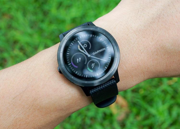 black Garmin Forerunner smartwatch with a digital second hand display for nursing